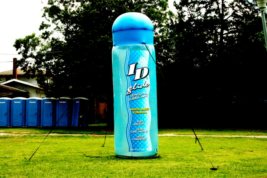 Inflated mock up of ID lube bottle on grass.