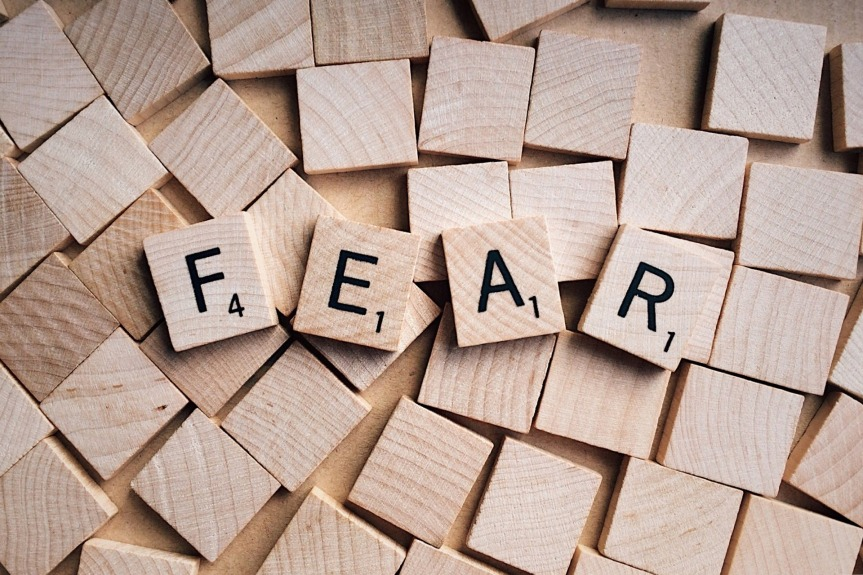 Wooden scrabble blocks spelling out the word 'FEAR'