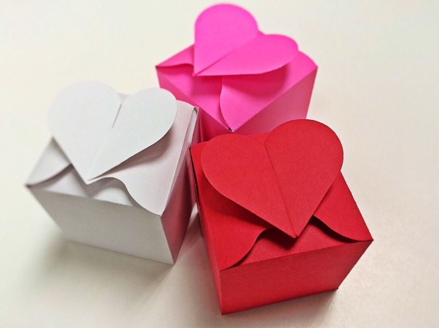 Three card boxes with heart shaped openings on top.