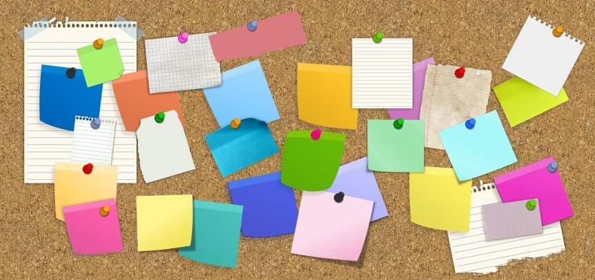 cork notice board with colourful post-its and note paper