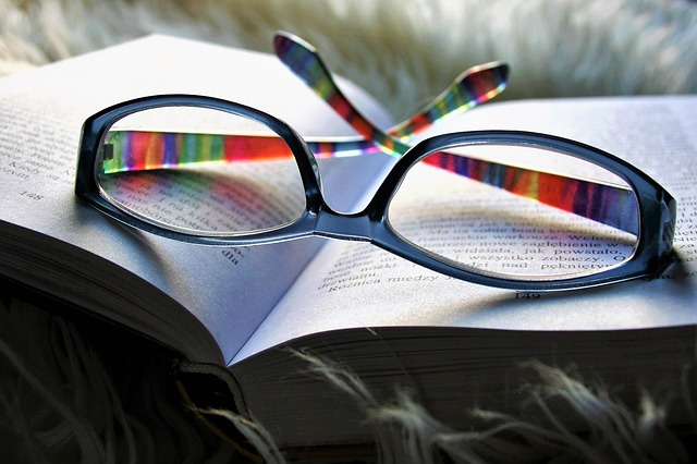 open book with a pair of glasses on top